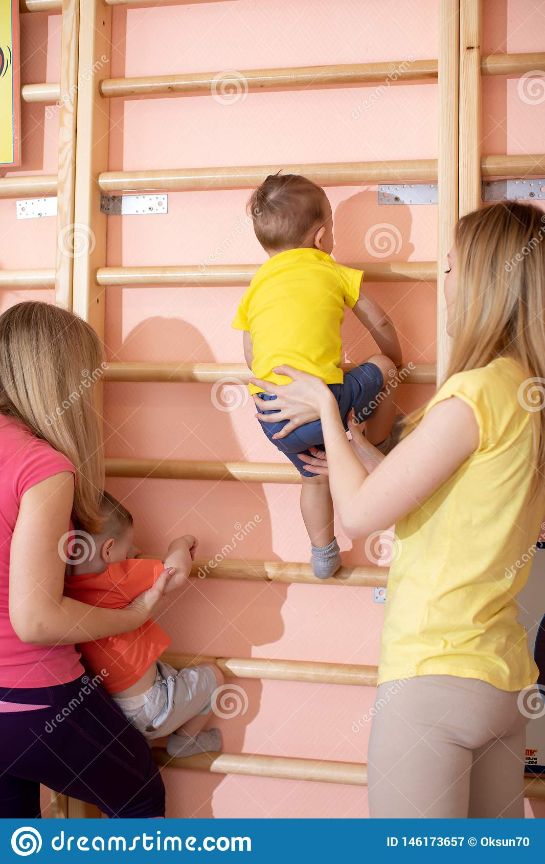 Little children toddlers climbing up the gymnastic stairs. Healthy lifestyle from childhood
