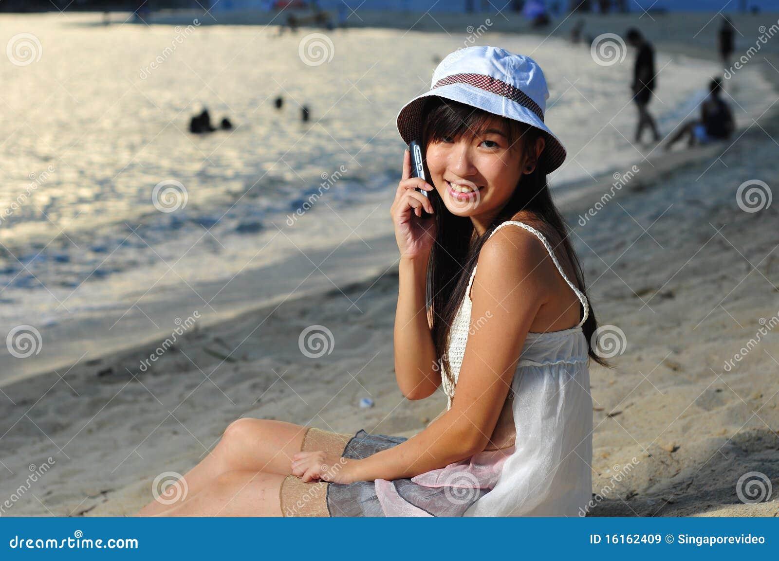 Chinese girl on beach seems brilliant