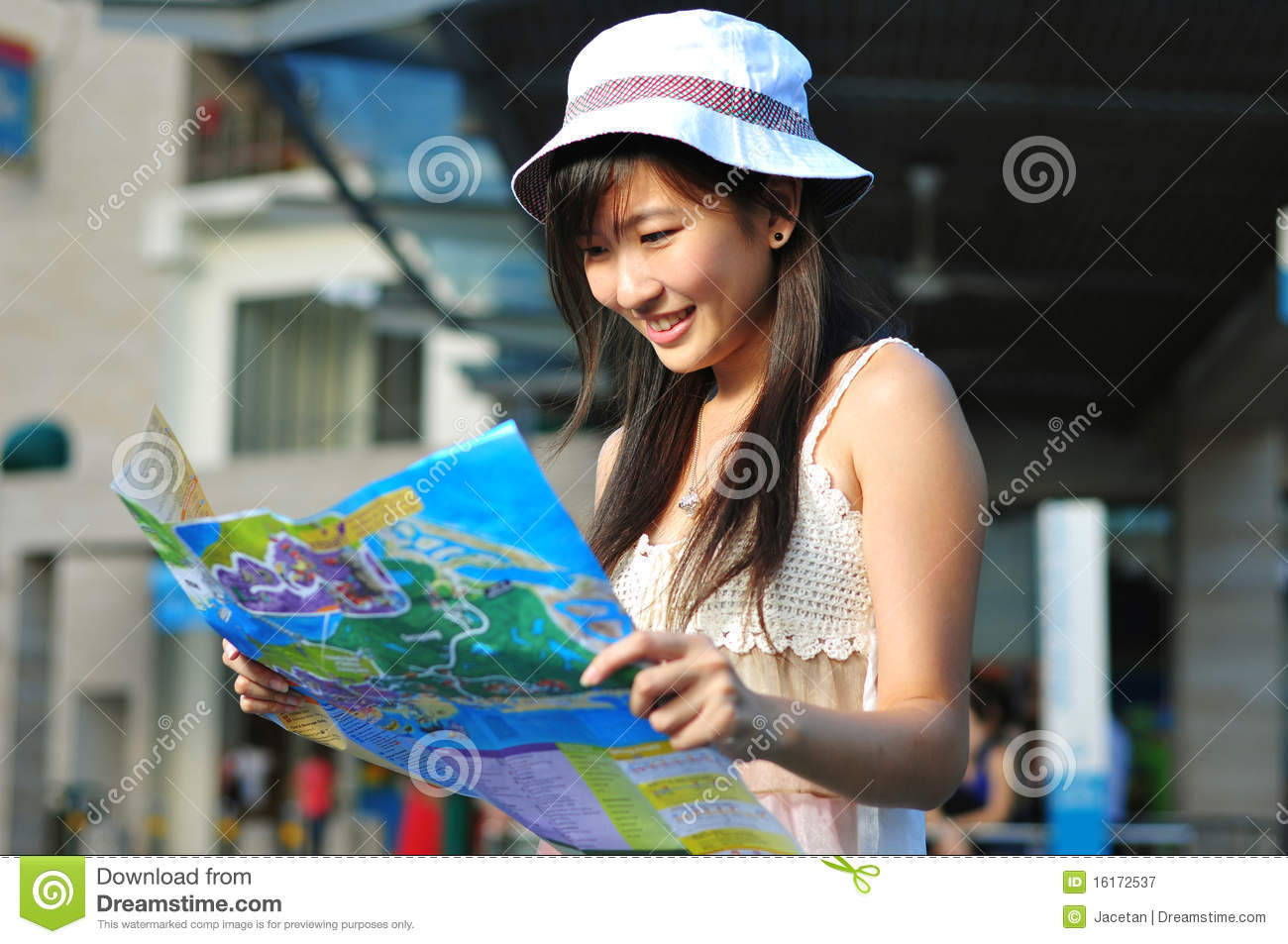 Little Chinese Asian Tourist Girl Using Her Map 2 Stock