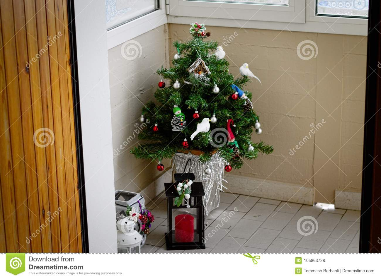Little Christmas Italy.Little Christmas Tree In The Corner With Lamps Stock Photo