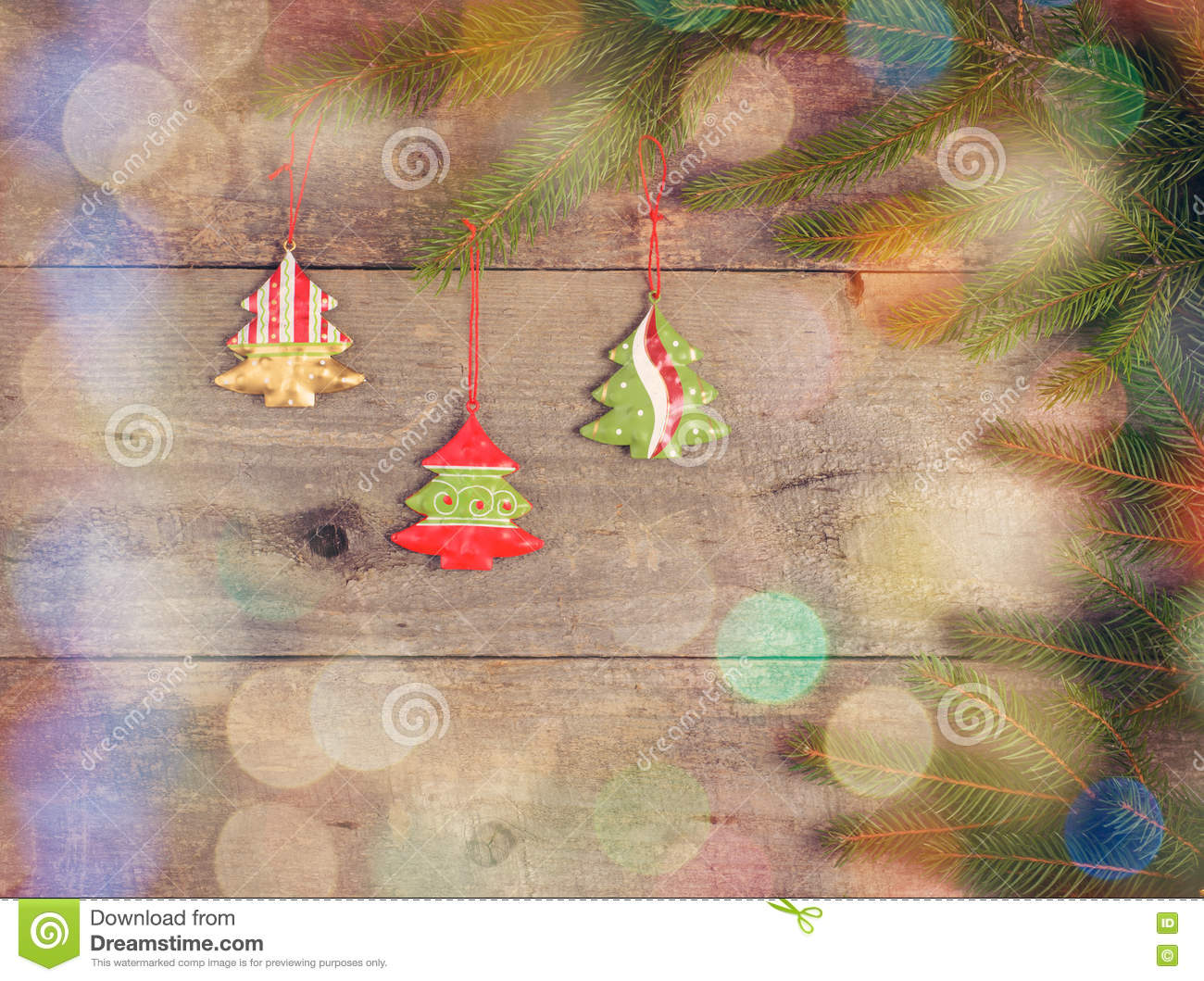Little Christmas Tree Toys On Pine Branch On Wood Table