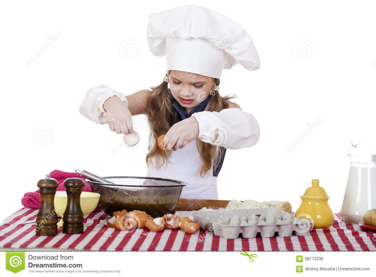 White apron girl - Little Cook Girl In A White Apron Breaks Eggs In A Deep Dish