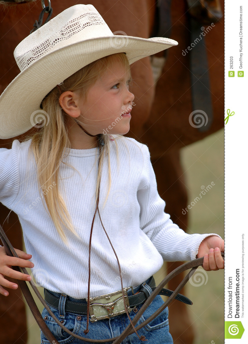 little cowgirl holding reins stock photos image 263203