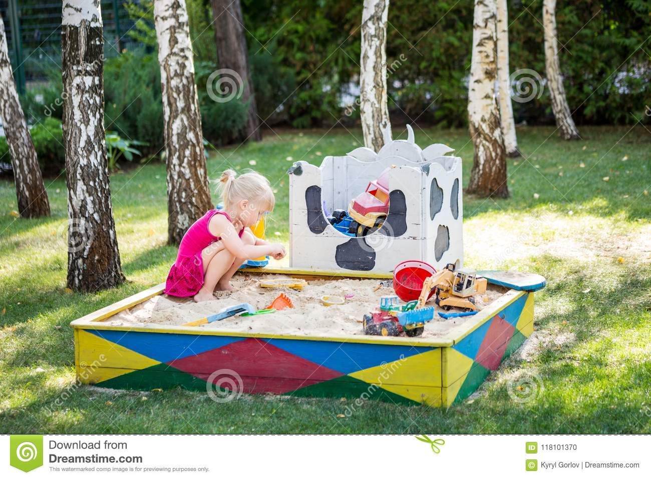 Little Cute Baby Girl Play In Wooden Sandbox  Child On Sand