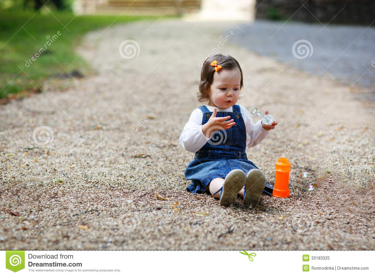 Little Cute Baby Girl Playing With Soap Bubbles In Summer