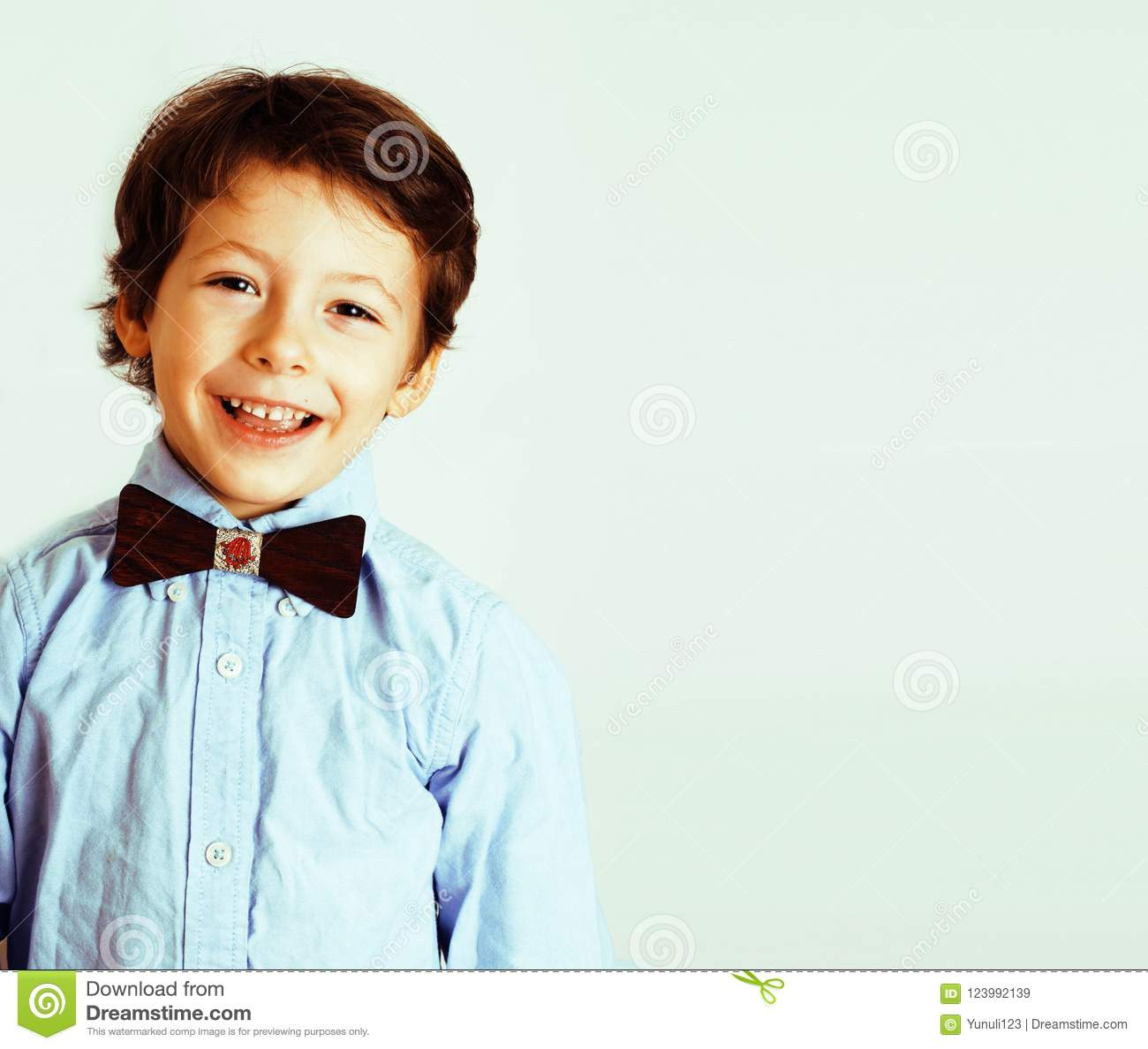 little cute boy on white background gesture tumbs up smiling clo