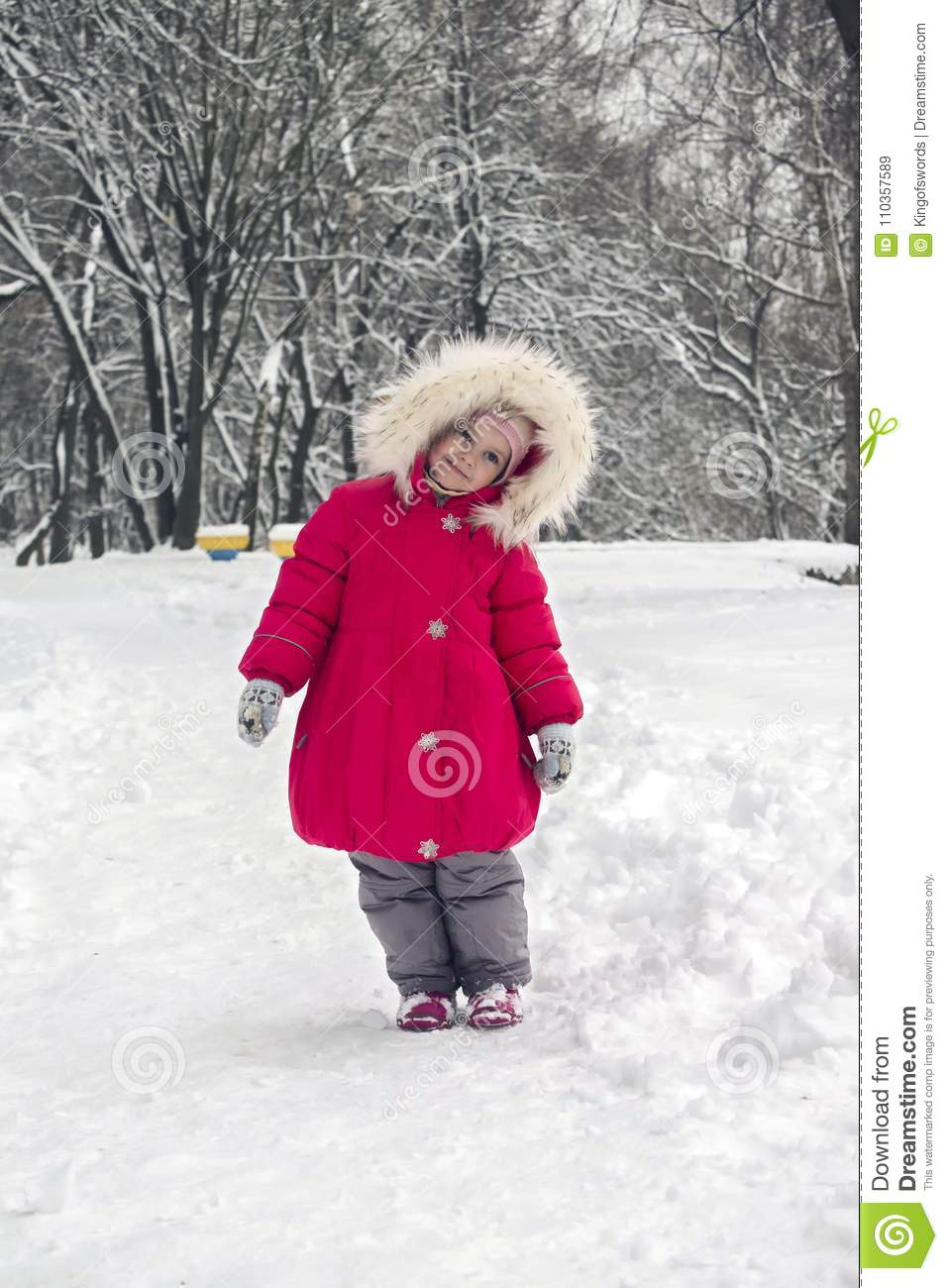 43b33c6bd Little Cute Girl In A Bright Red Jacket And Fur Hood Standing In A ...