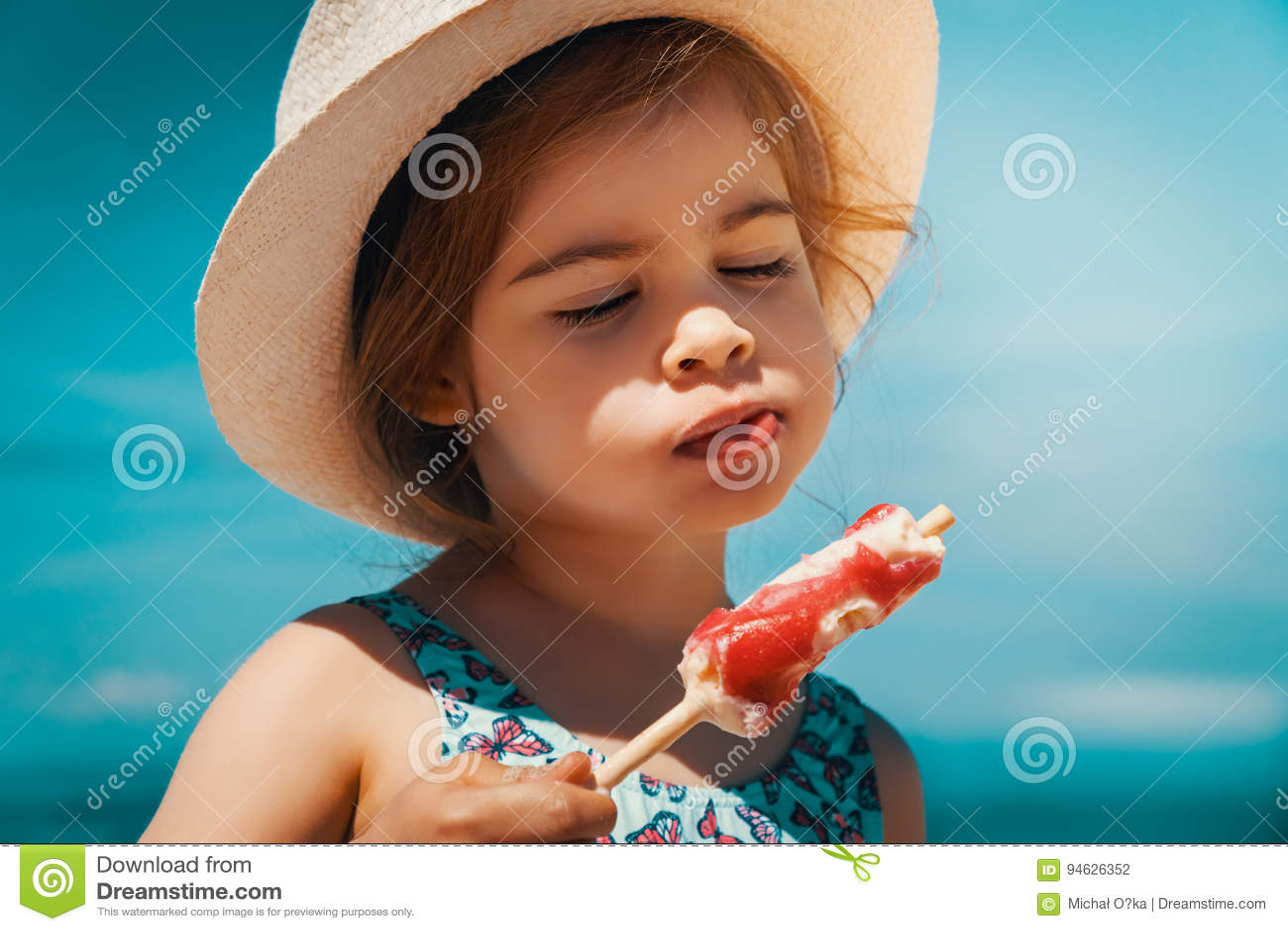 Happy Little Girls Eating Ice-cream Over Summer Beach