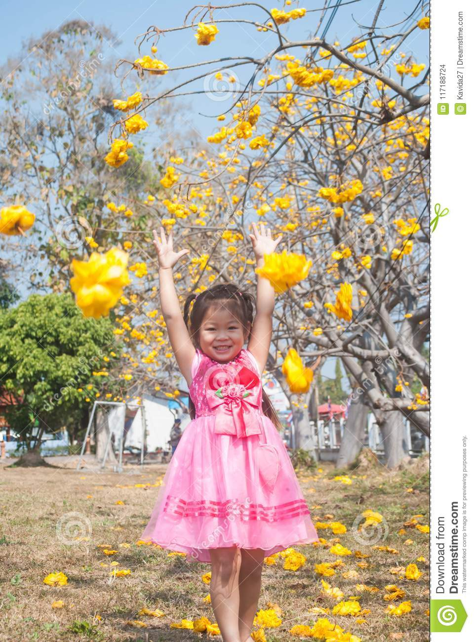 Healthy Little Cute Girl In Pink Dress With Yellow Flowers Stock