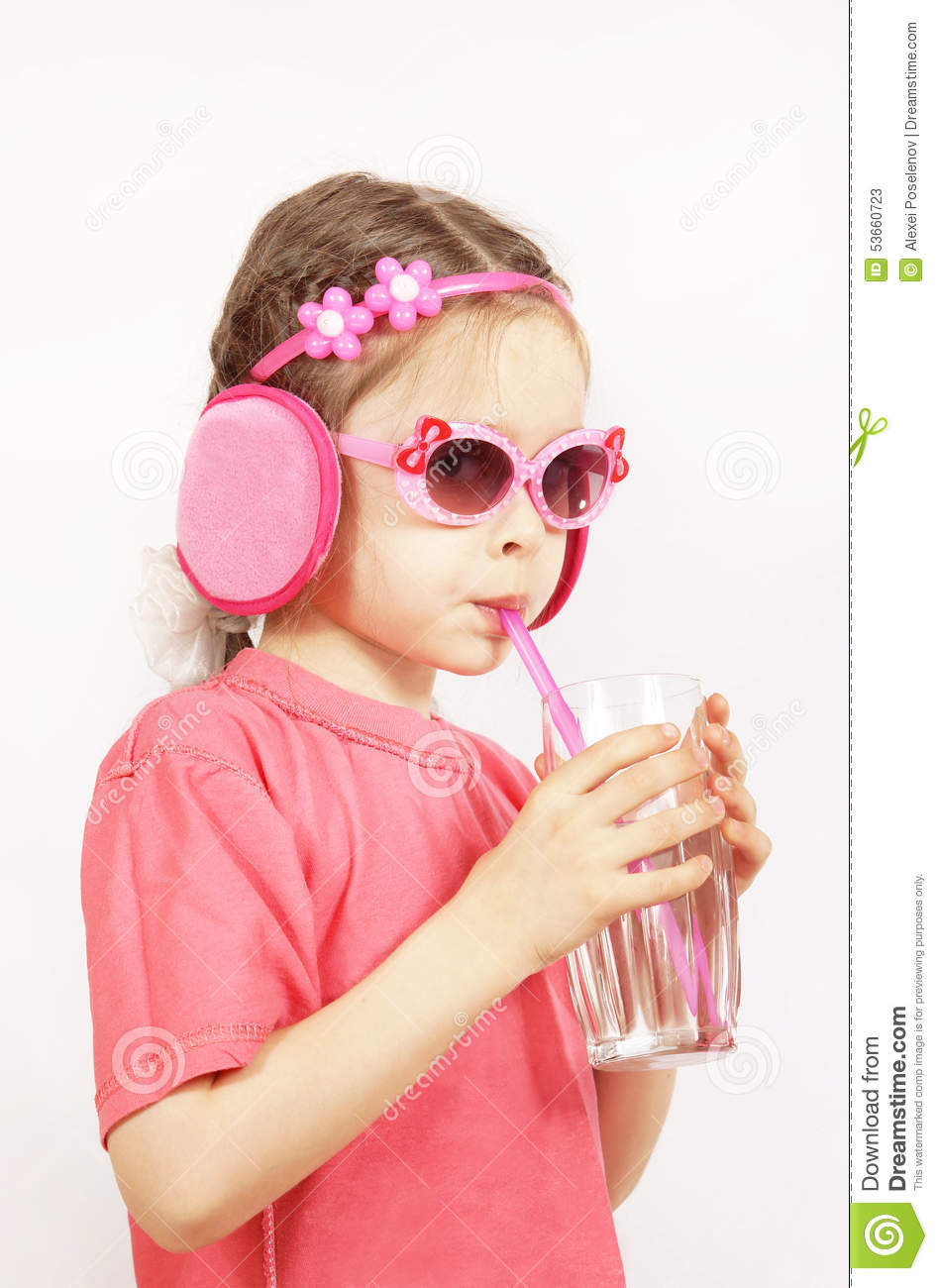 Little Cute Girl Wearing Pink Clothes Is Drinking Water ...