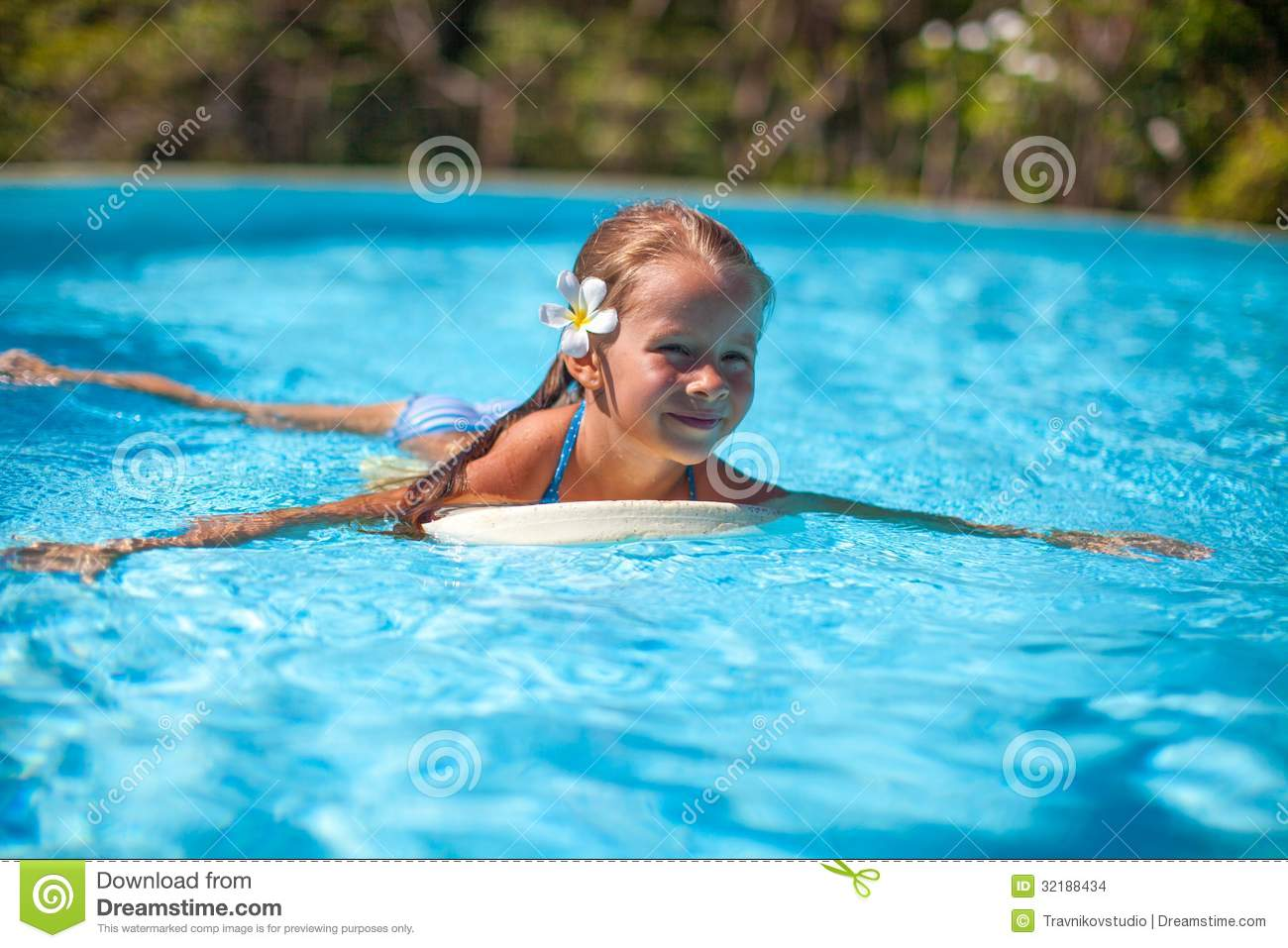 Little cute happy girl swims in the swimming pool stock for Cute pool pictures