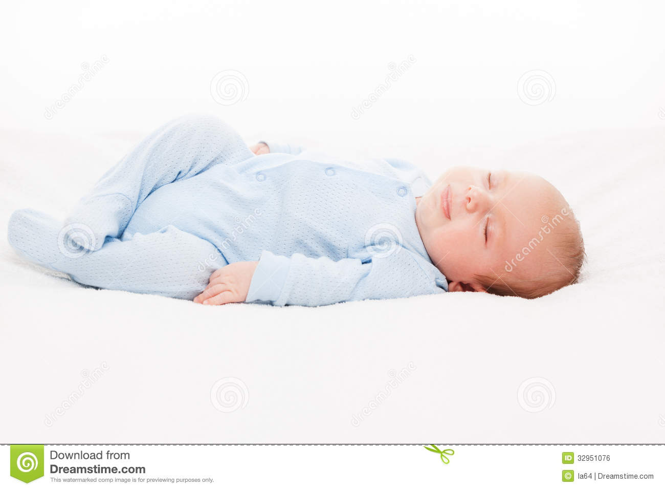 Little cute newborn baby child sleeping royalty free stock for Sleeping bed