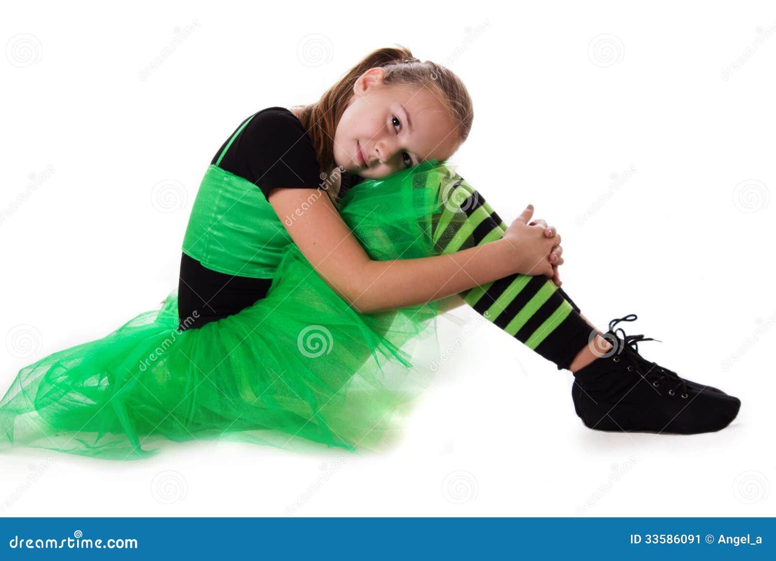 Little Dancer In Green Tutu Skirt Sitting Stock Image