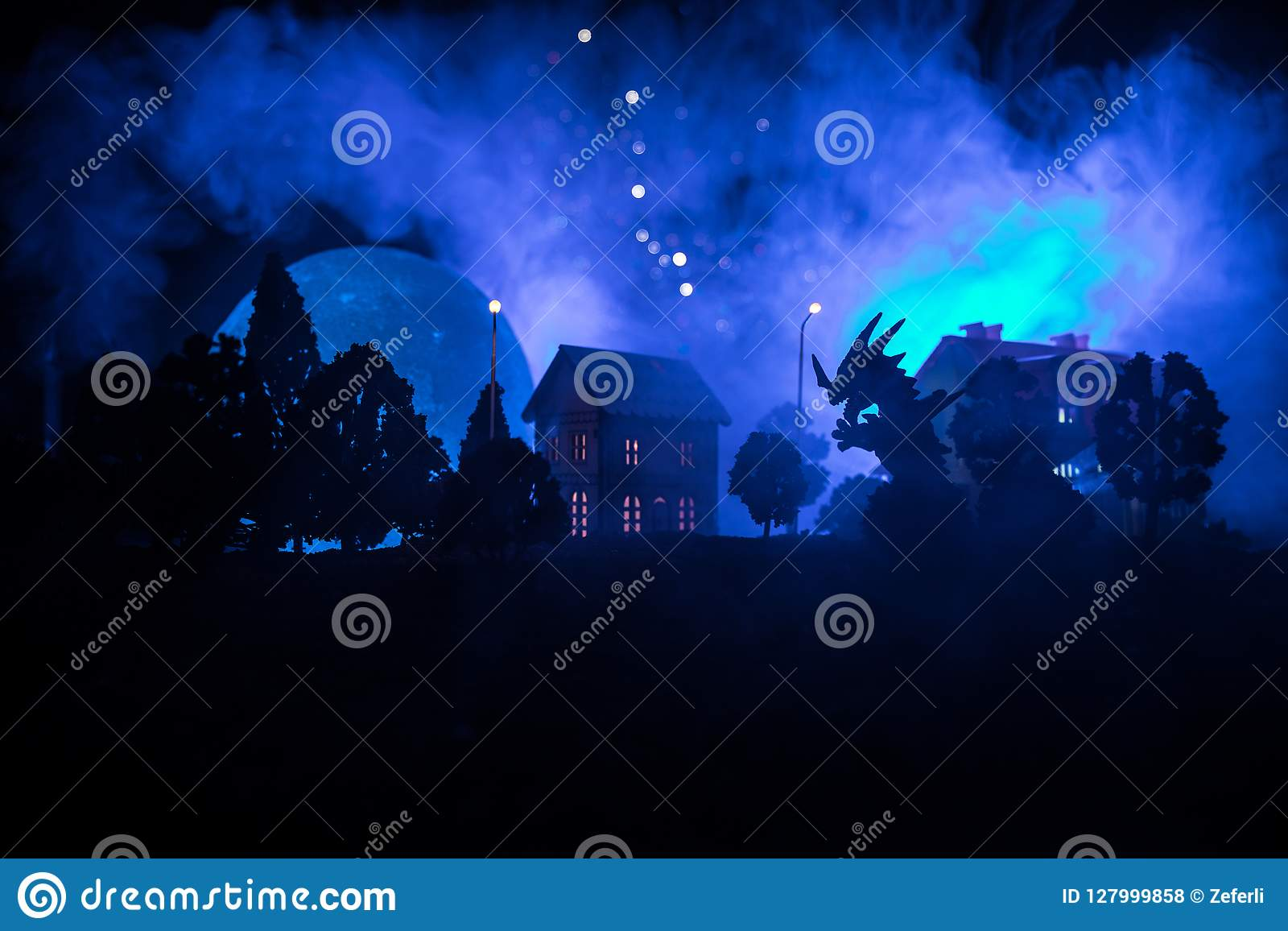 Little decorative houses, beautiful festive still life, cute small houses at night, pine trees glowing lights, happy winter holida