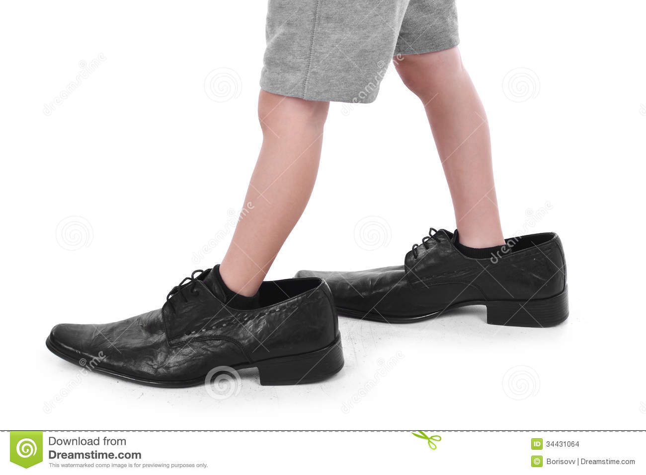 Feet In Kids Shoes Clipart