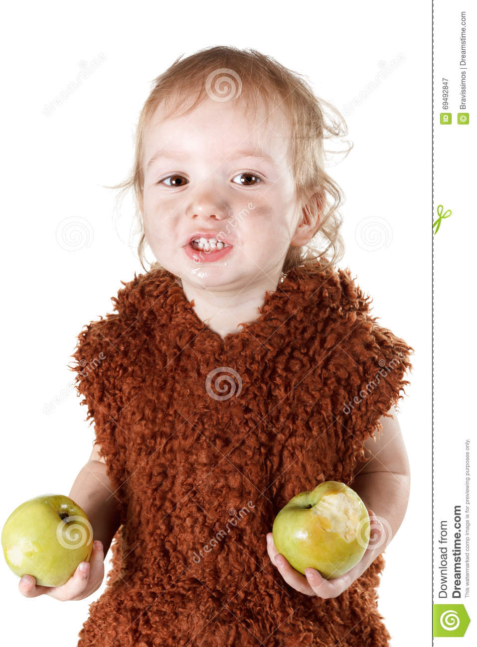 Little funny Neanderthal boy in a suit with dirty face eating an apple.