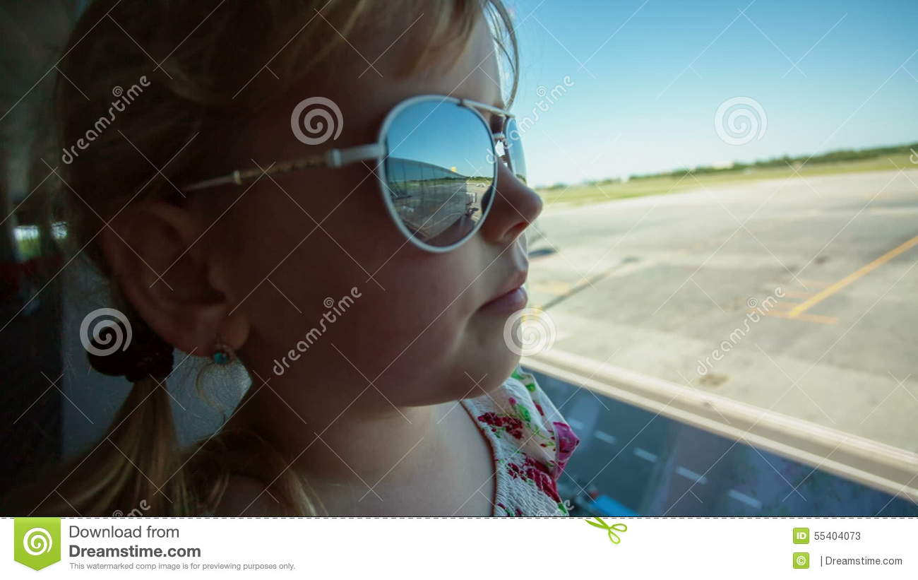 Little Girl At The Airport Looks Out The Window Stock Video