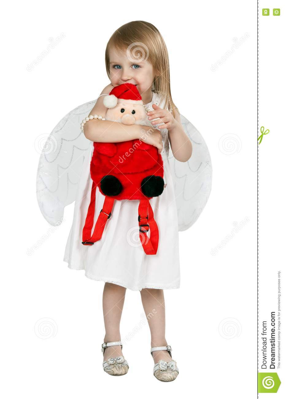 Little girl with angel wings and a red santa claus royalty