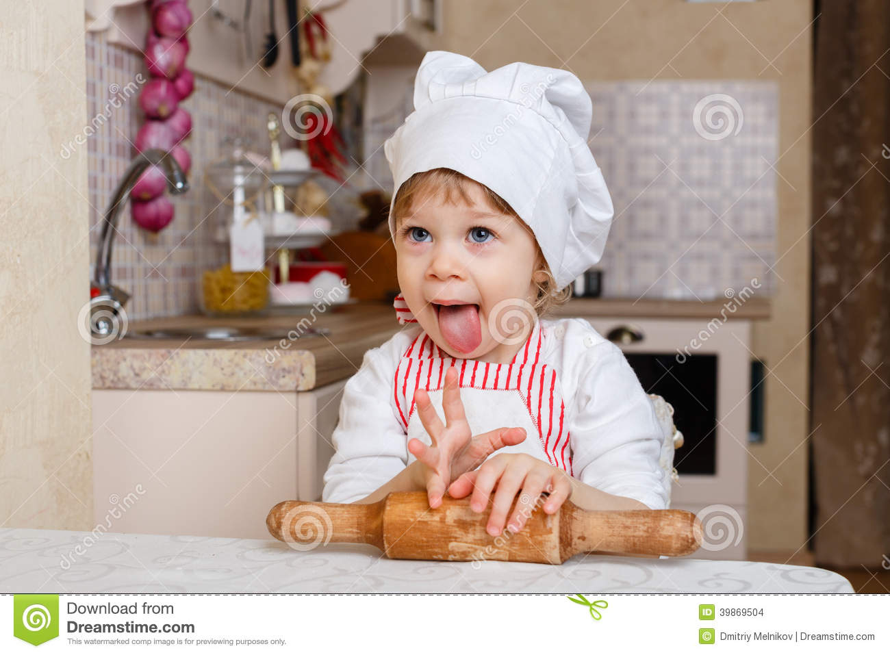 little girl in apron in the kitchen stock photo image 39869504