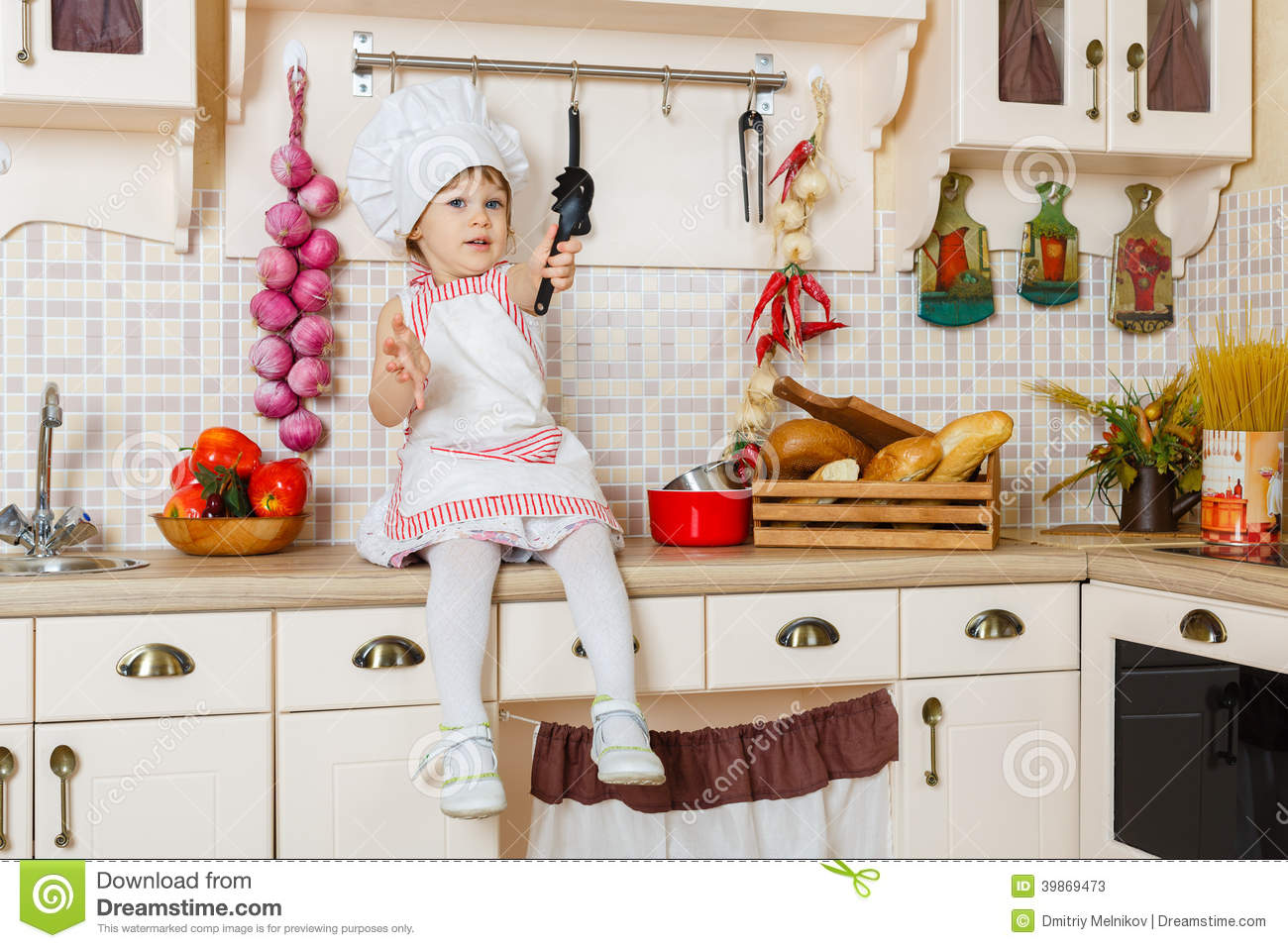 little girl in apron in the kitchen stock photo image 39869473