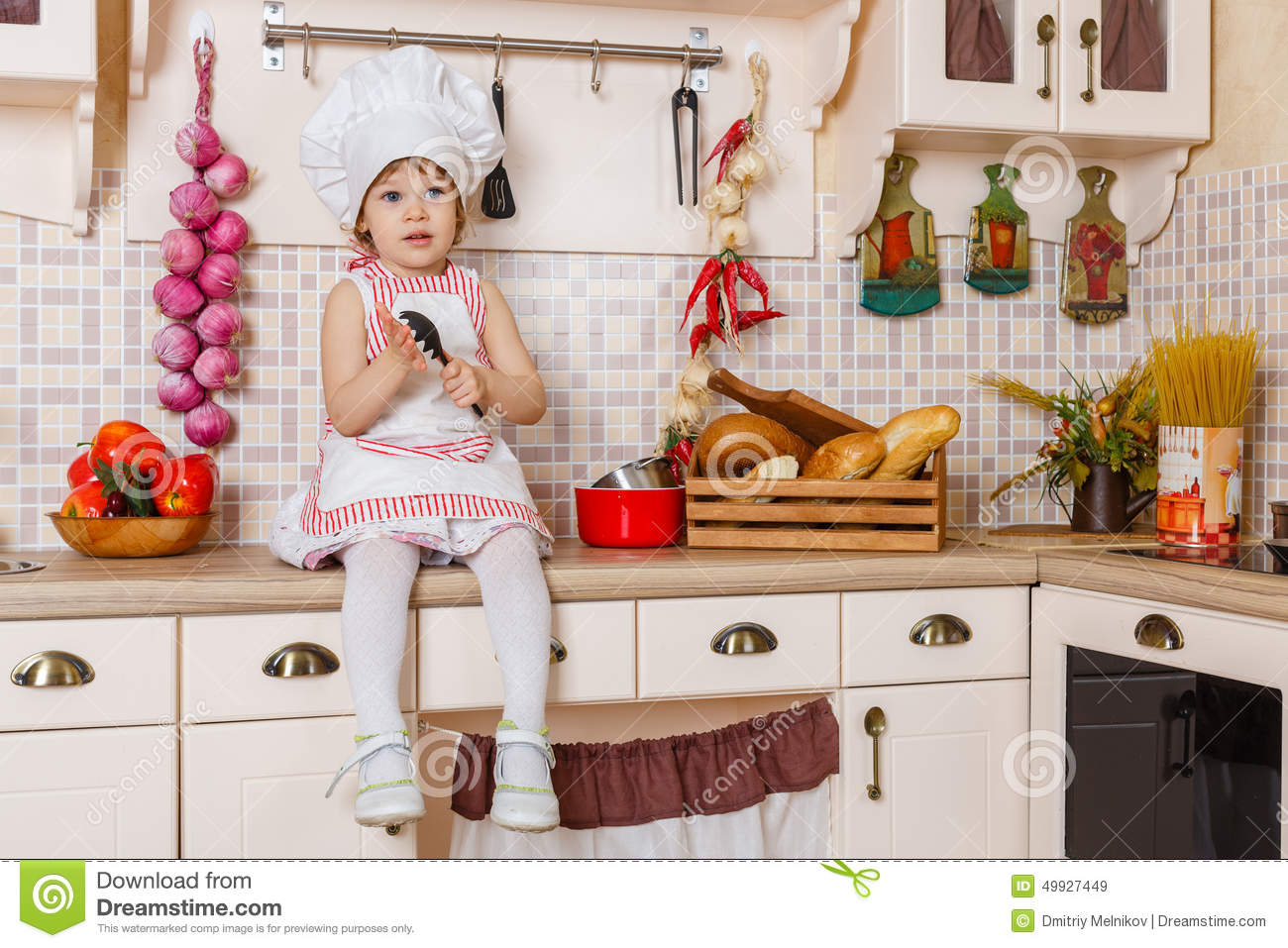 Little Girl In Apron In The Kitchen. Stock Image - Image of food ...