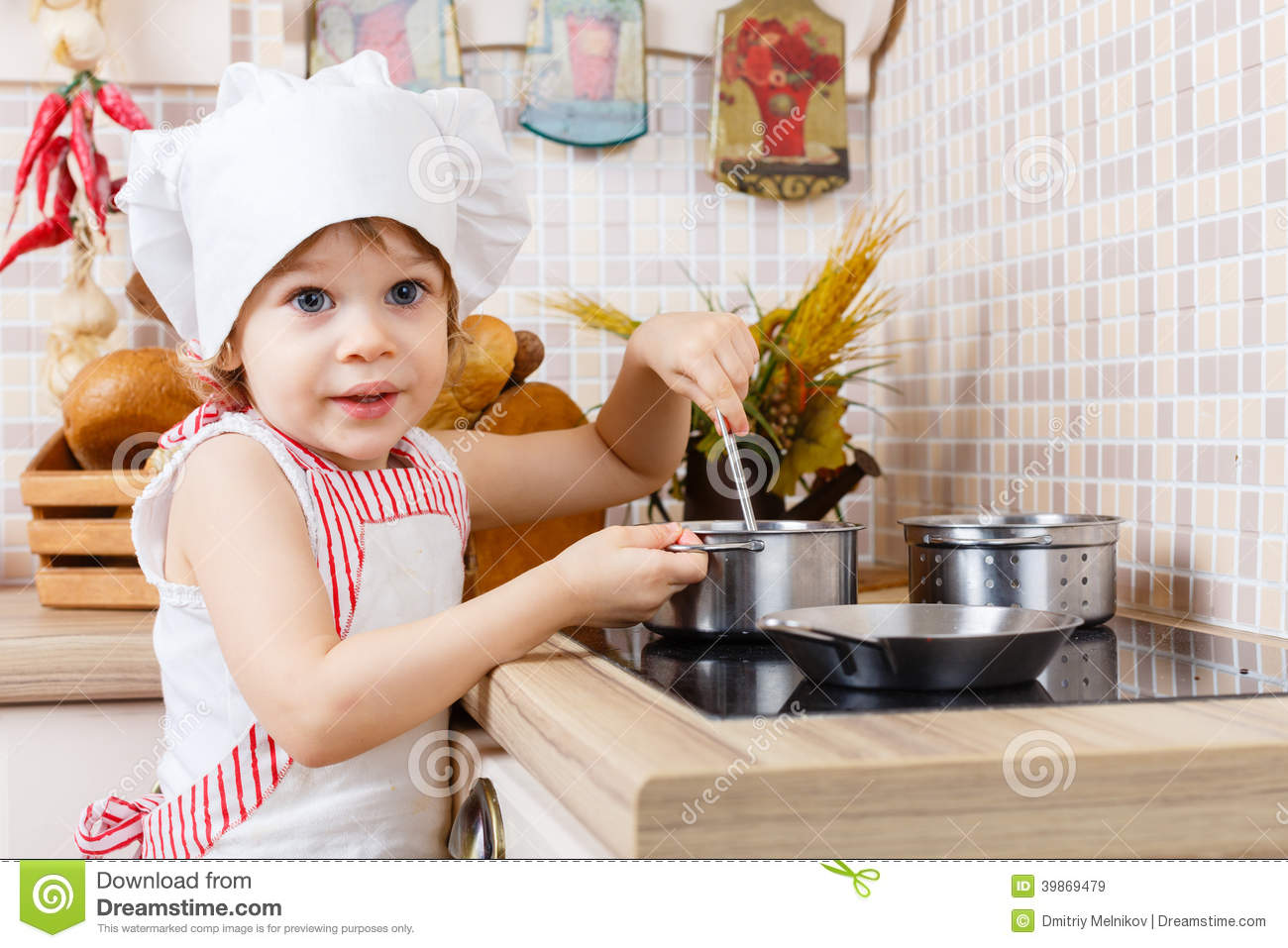 little girl in apron in the kitchen stock photo image 39869479