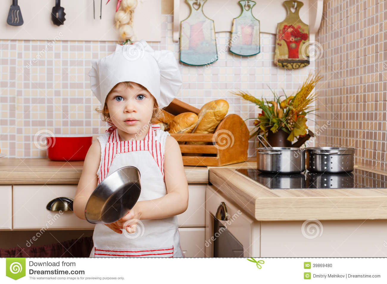 little girl in apron in the kitchen stock photo image 39869480