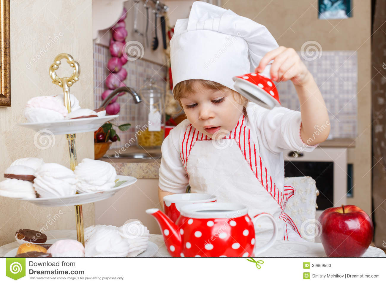 little girl in apron in the kitchen stock photo image 39869500