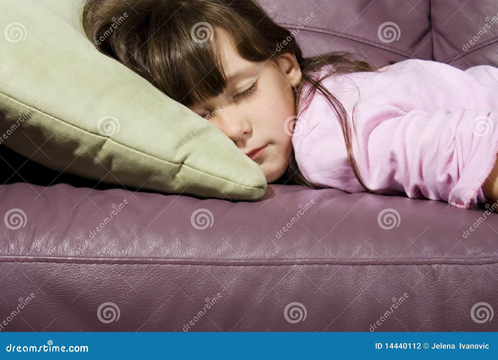 little girl asleep on couch stock photography