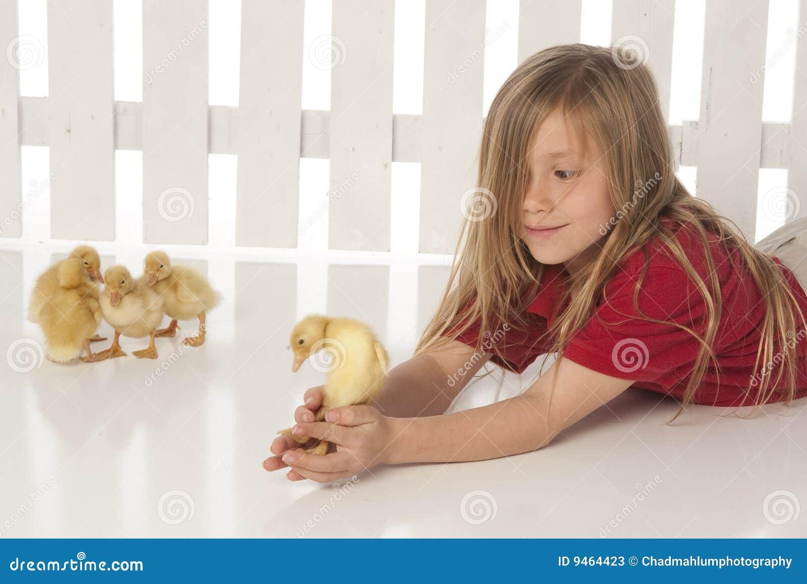 Naked Girl Holding Ducks