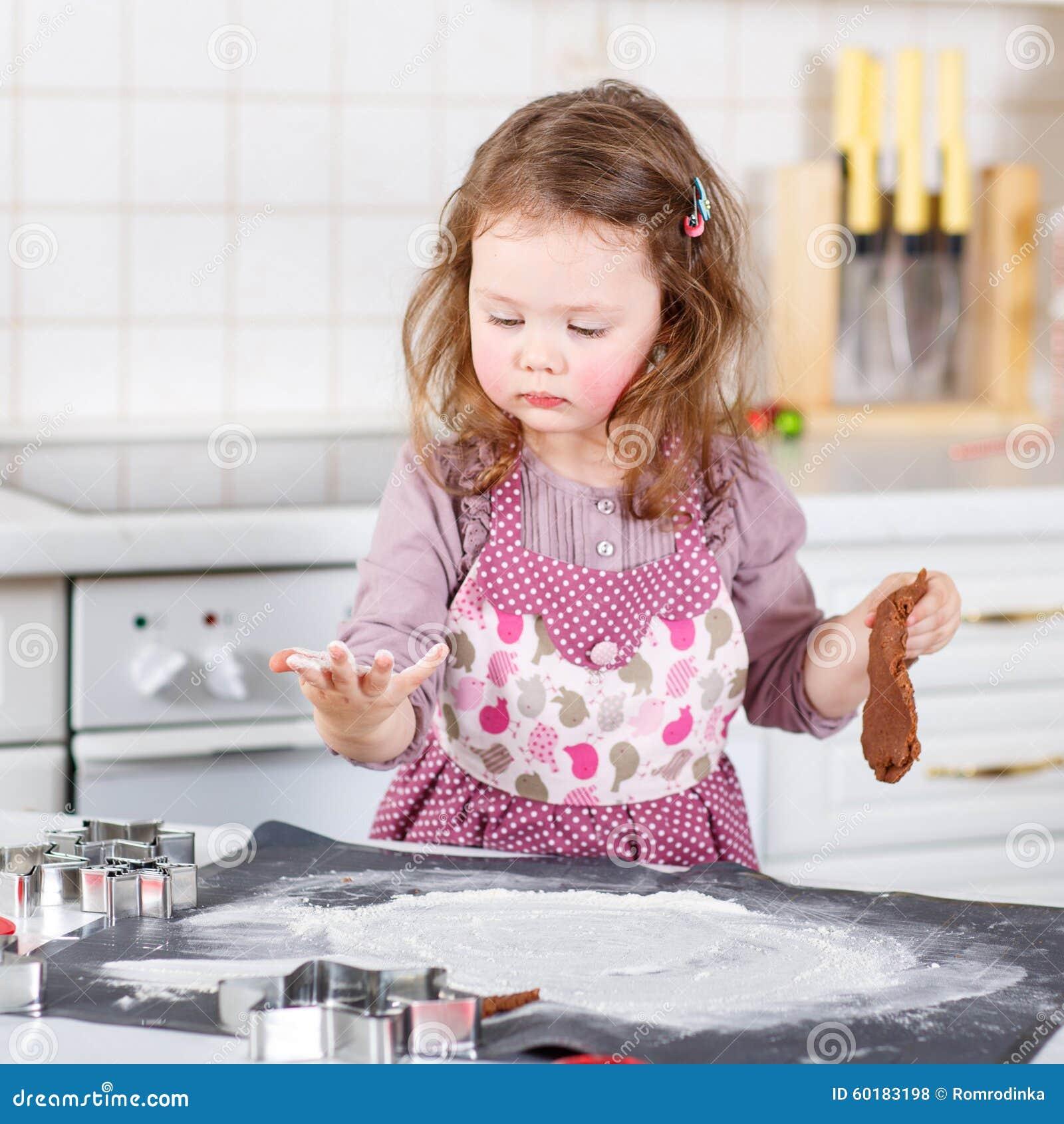 Happy Girl Kitchen: Happy Child Enjoying Baking At Home Royalty-Free Stock