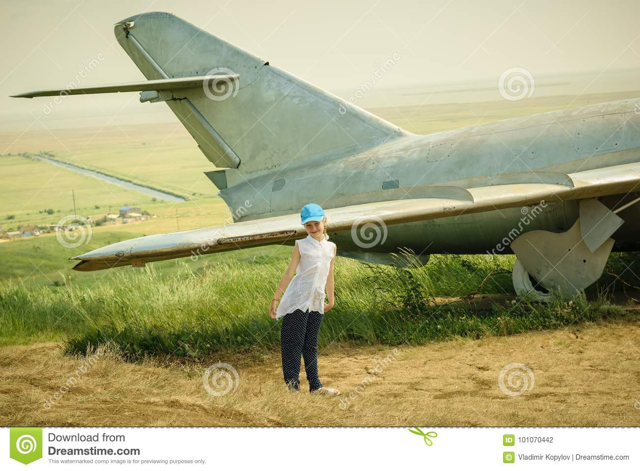 6c90f8e2d Little Girl In A Baseball Cap At The Airport Near The Old Military ...