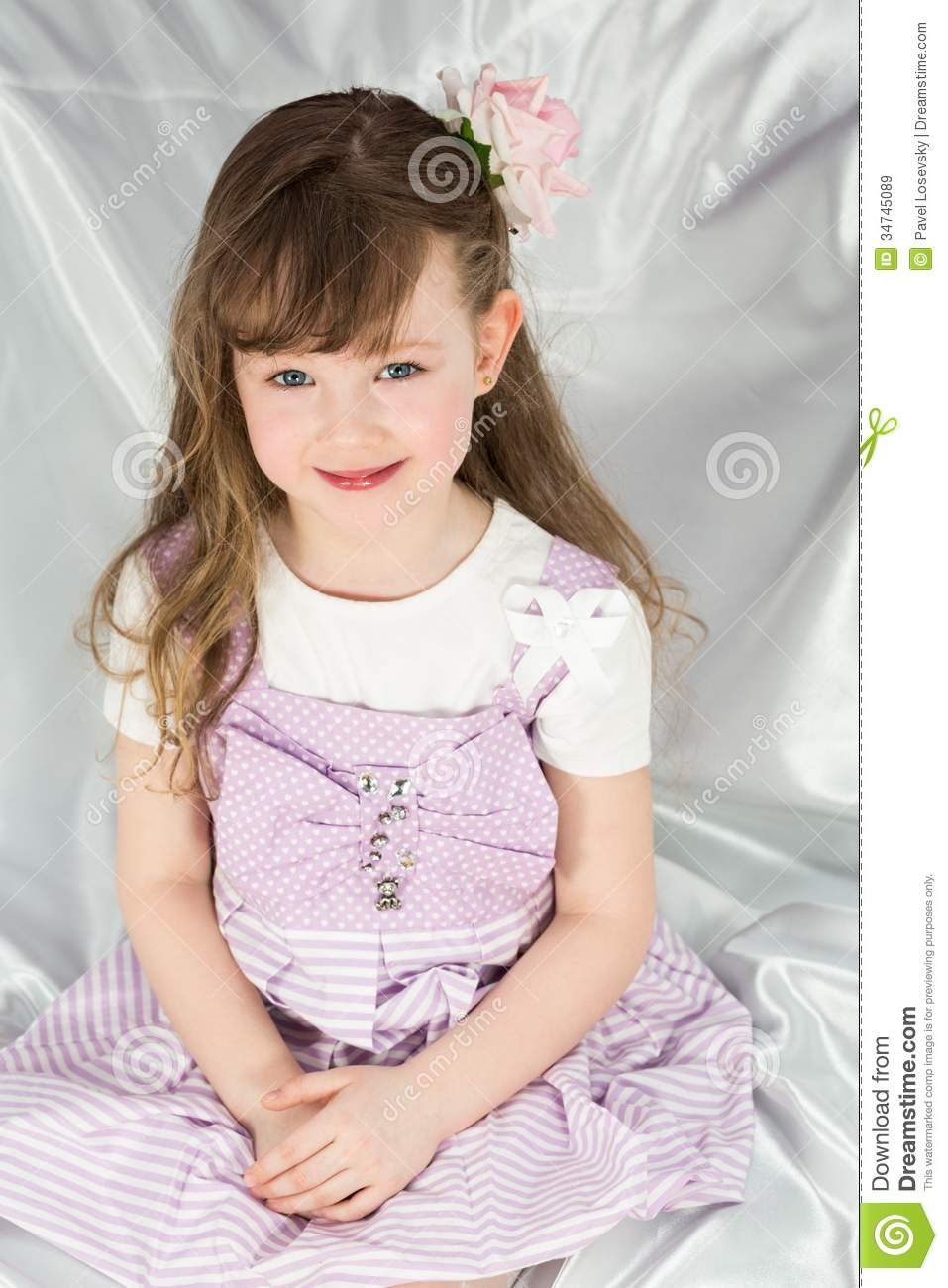 Little Girl In A Beautiful Dress With Flower Stock Image