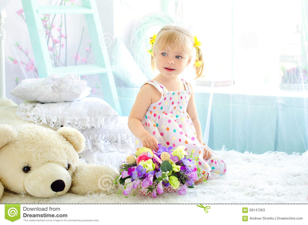 Little Girl On Bed With Flowers And Big Teddy Bear Stock