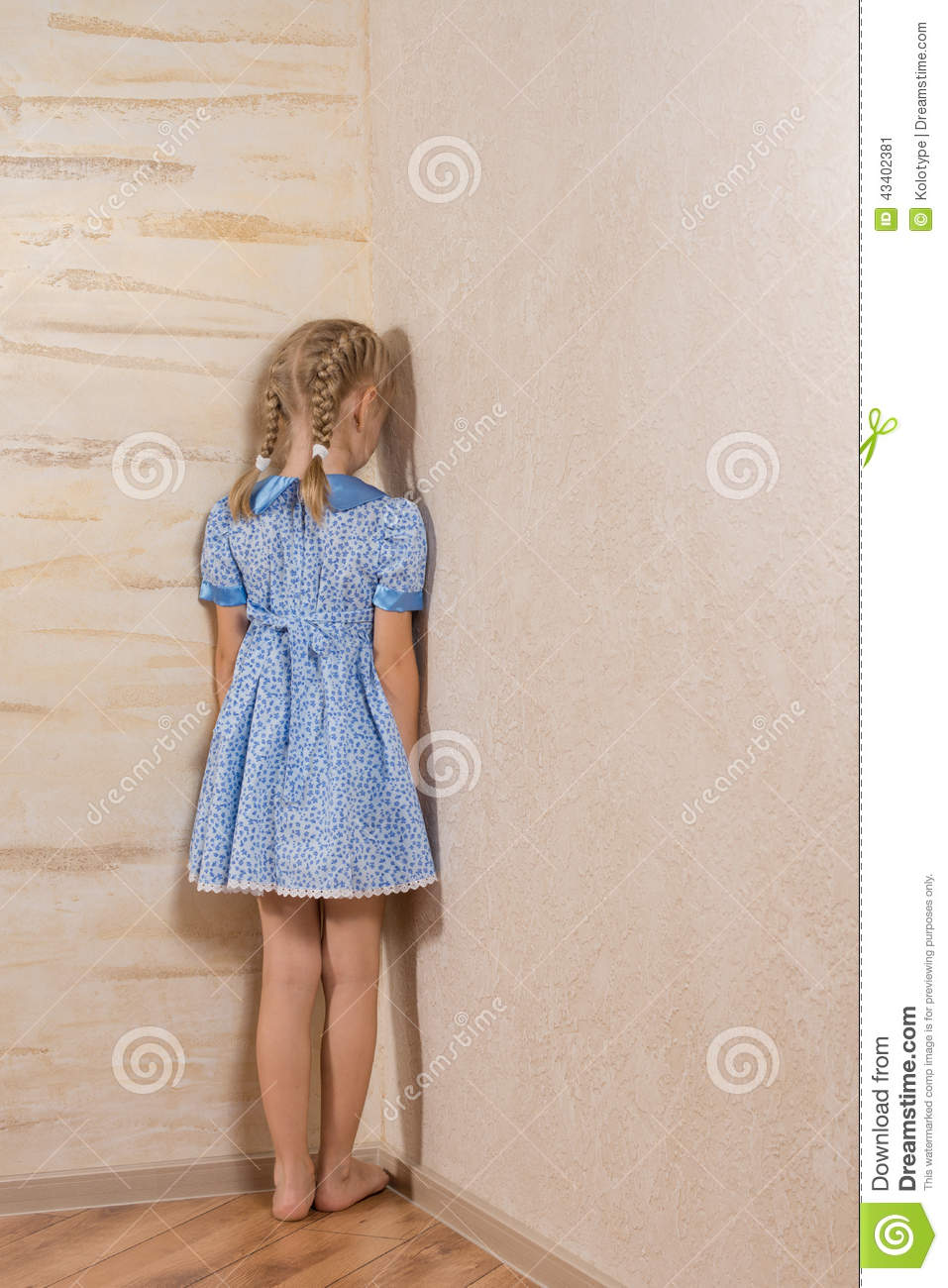 Standing In The Corner : Little girl being punished standing in the corner stock