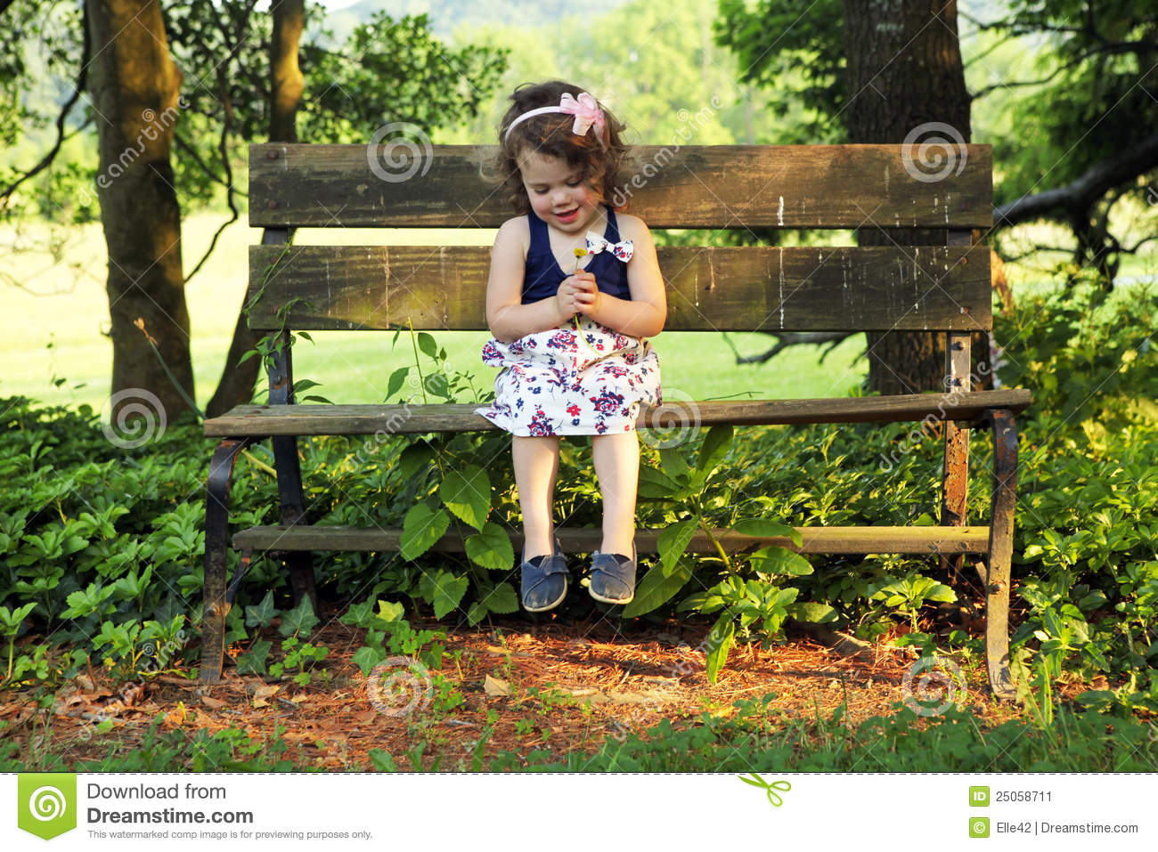 Girl Sitting Alone On Bench Little girl sitting on bench
