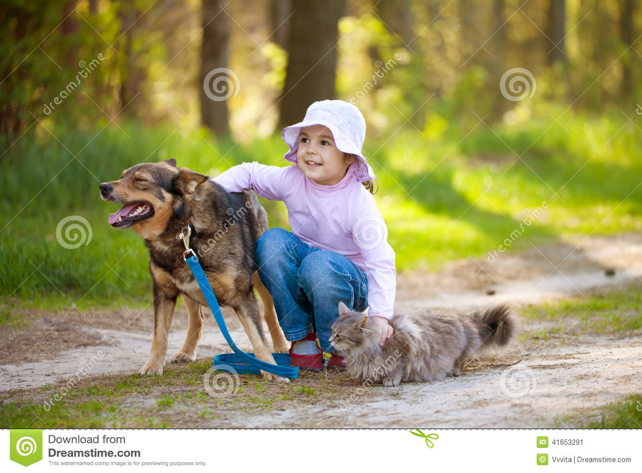 Little girl with big dog and cat