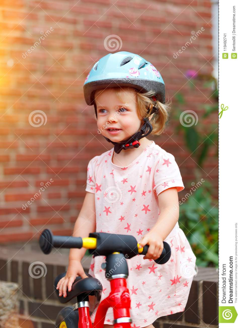 Little girl with a bike