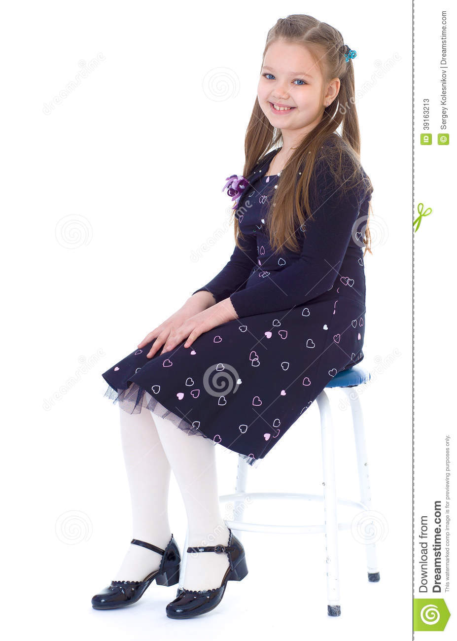 Black child sitting in chair - Royalty Free Stock Photo