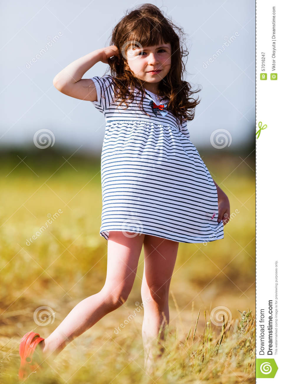 Little Girl In A Black White Striped Dress Stock Photo