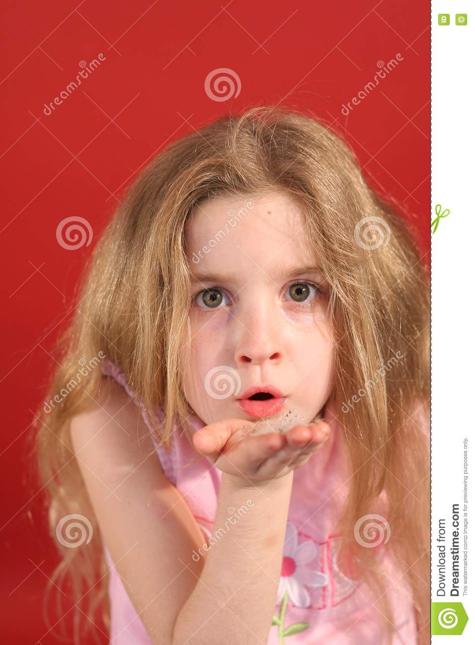 little girl blowing flowers stock image