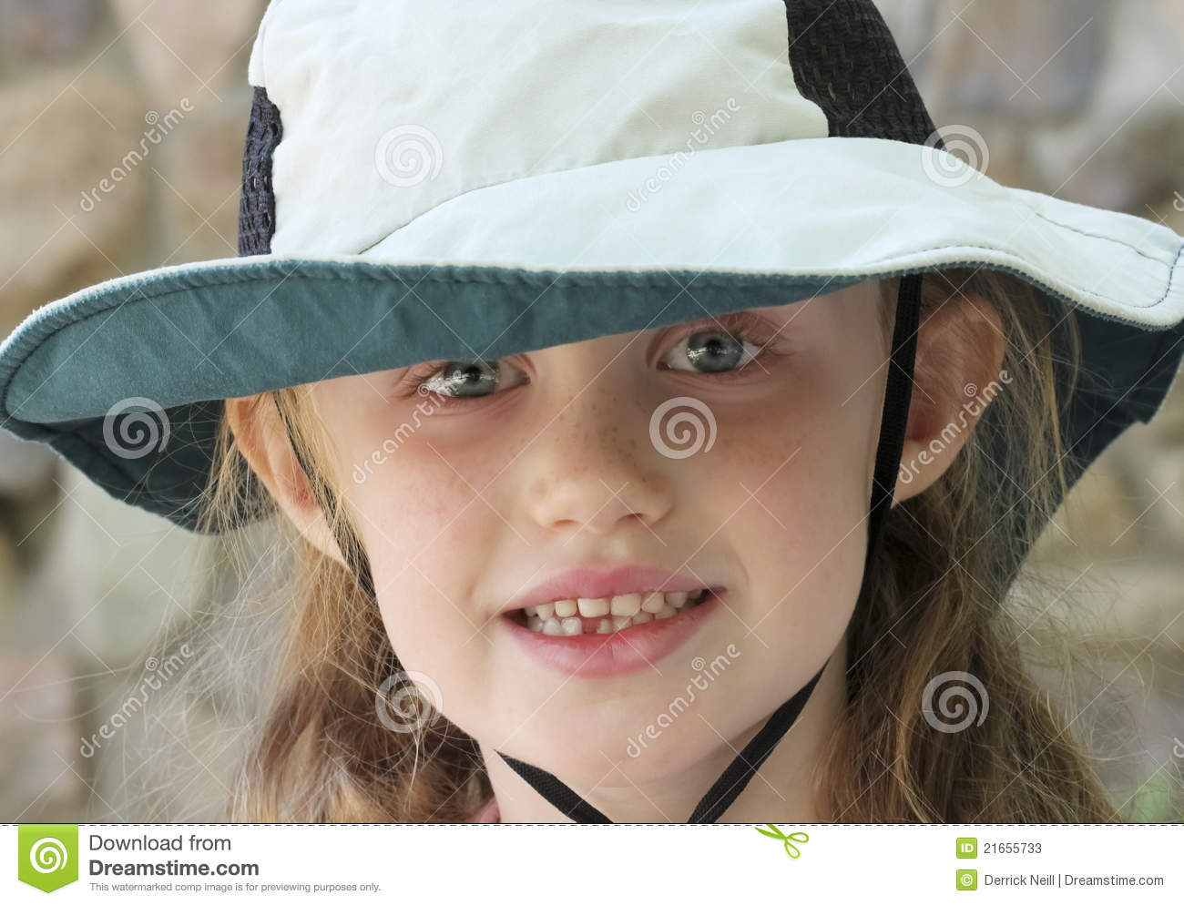 a98ee7ad114 A Little Girl With Blue Eyes And A Floppy Sun Hat Stock Image ...