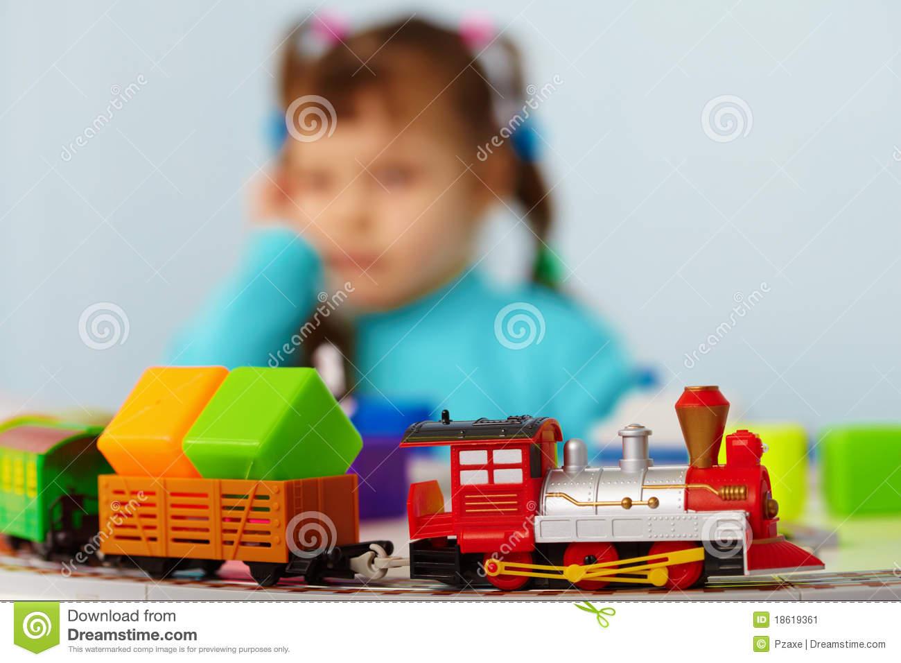 Little Girl Toys : Little girl bored playing with toys alone stock image
