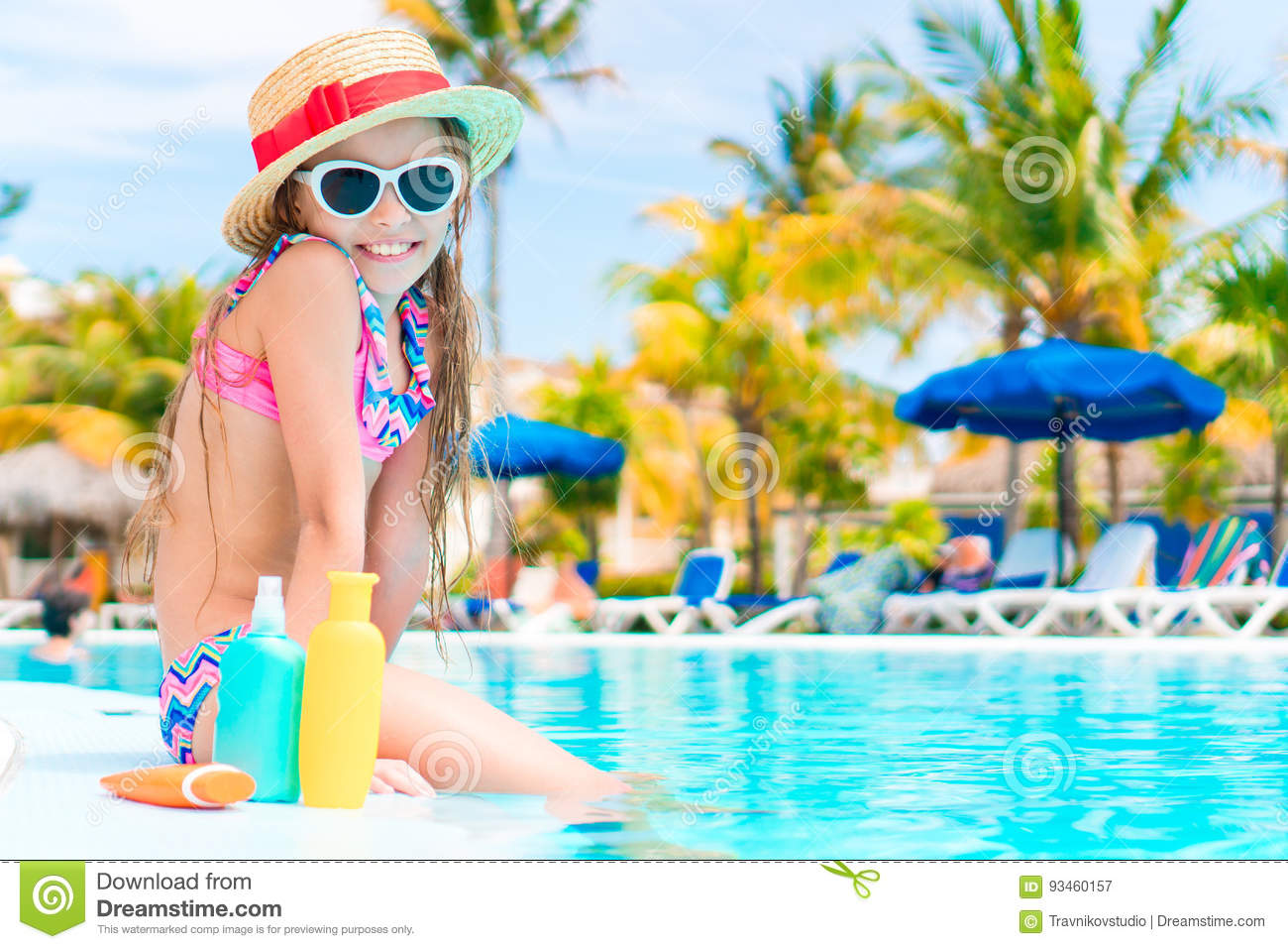 Little Girl With Bottle Of Sun Cream Sitting On The Edge Of Swimming ... b68dd63411f