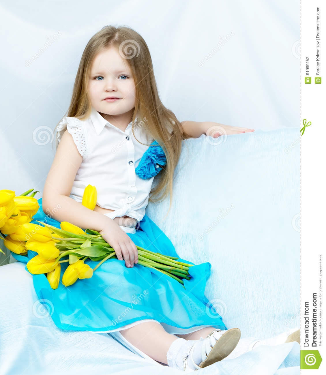 Little girl with bouquet of tulips