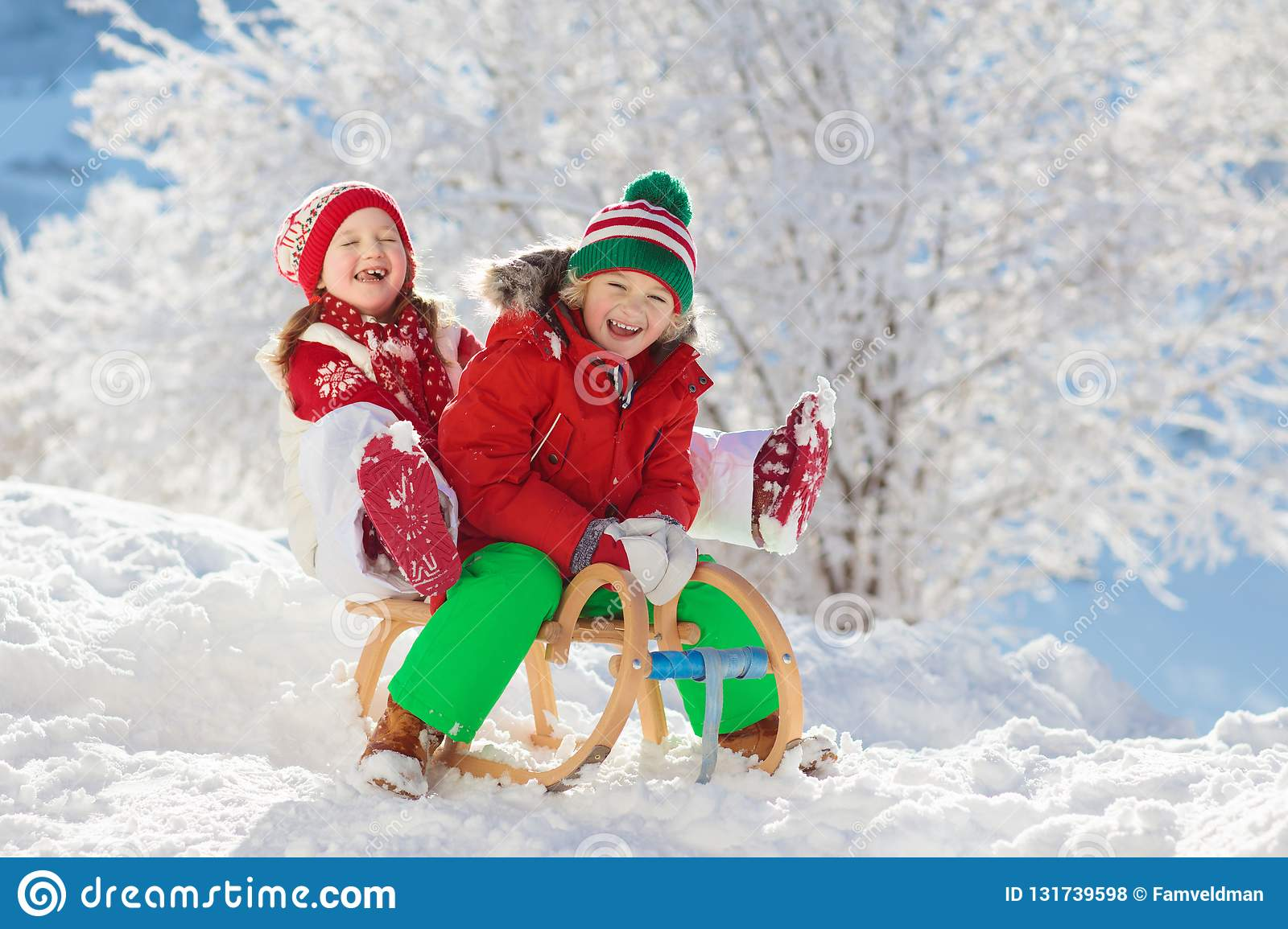 Little Girl And Boy Enjoying Sleigh Ride Child Sledding Toddler