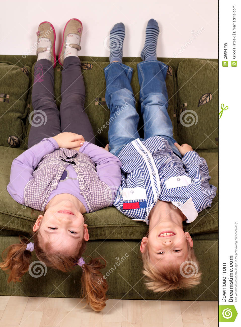 Cute little boy lying on the bed royalty free stock for Boys and girls in bed