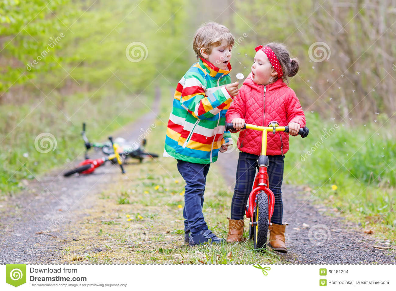 be09cec80 Little Girl And Boy Playing Together In Forest Stock Photo - Image ...