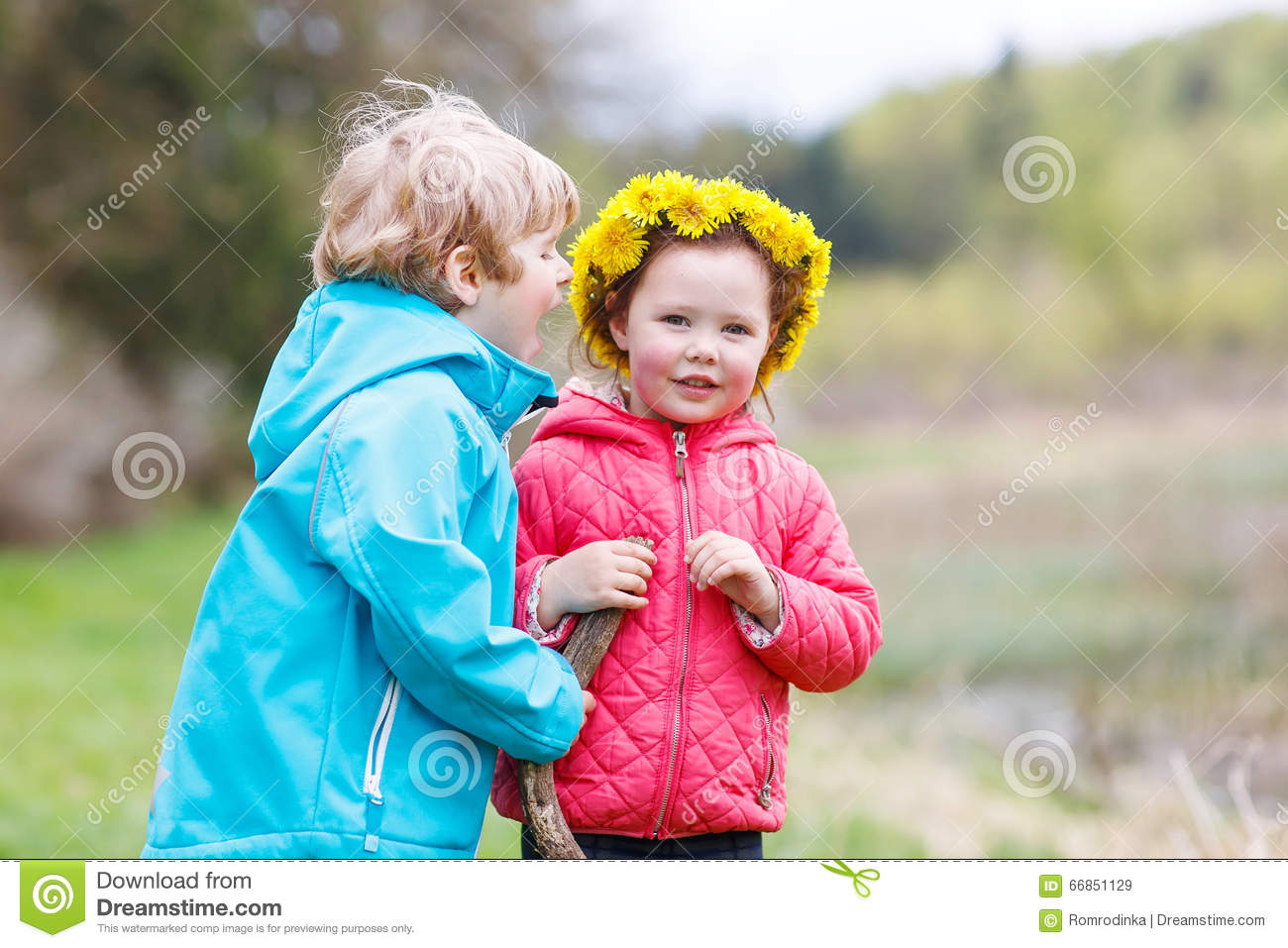 51f6b8e34 Little Girl And Boy Playing Together In Forest Stock Image - Image ...