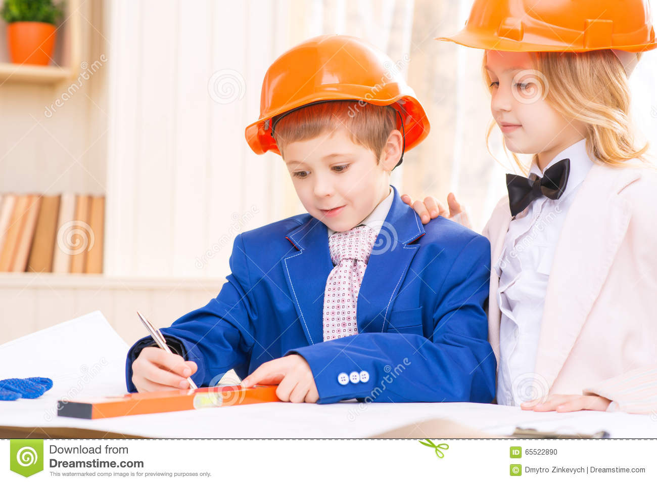 Little Girl And Boy Are Working With Construction Papers